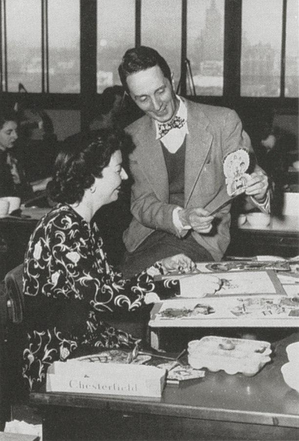Norman Rockwell visits with Hallmark illustrators, c. 1949.